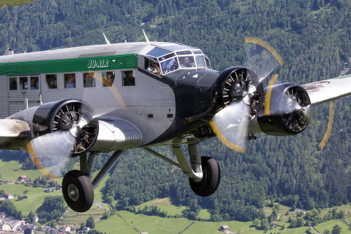HANDOUT - Undated pic of a JU-52 aircraft of the JU-AIR in the air. A JU-52 of the JU-AIR crashed on Saturday afternoon, 04 August 2018 at Piz Segnas above Flims, Switzerland. Swiss police say all 20 people aboard an old-time propeller plane were killed when the aircraft crashed into a mountainside in southeast Switzerland. (JU-AIR/Keystone via AP)