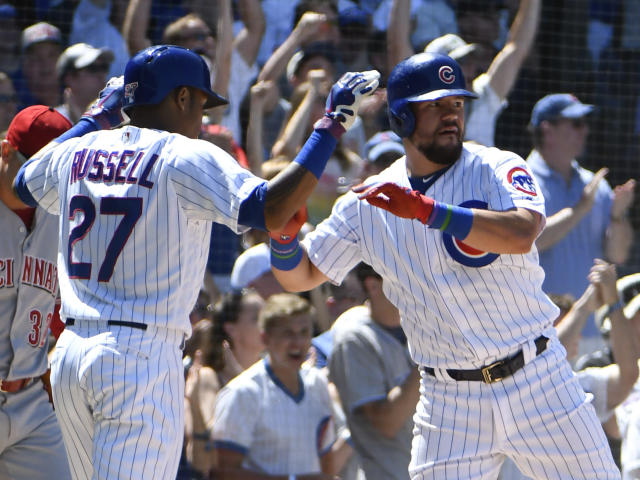 Chicago Cubs' Kyle Schwarber, right, is greeted by Addison Russell (27) after scoring against the Cincinnati during the fourth inning of a baseball game Saturday, July 7, 2018, in Chicago. (AP Photo/David Banks)