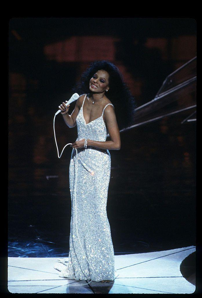 <p>Diana Ross performs in sparkling white gown.</p>