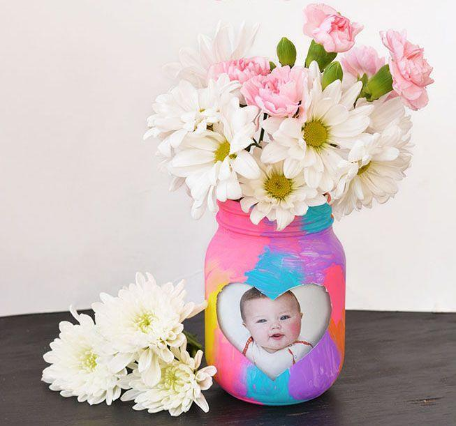 "<p>Acrylic paint can turn any jar into a planter that Mom would love to put on a table or a shelf. But leave a heart-shaped opening for a baby picture (clear contact paper helps you from accidentally painting in the heart area), and the project becomes extra special. </p><p><em><a href=""https://www.iheartartsncrafts.com/kid-made-picture-frame-vase/"" rel=""nofollow noopener"" target=""_blank"" data-ylk=""slk:Get the tutorial at I Heart Arts n Crafts »"" class=""link rapid-noclick-resp"">Get the tutorial at I Heart Arts n Crafts »</a></em></p>"