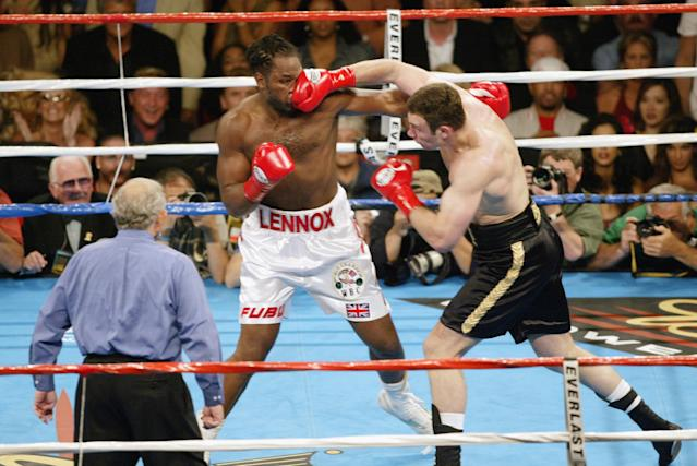 Vitali Klitschko (R) lands a right on Lennox Lewis in their classic 2003 heavyweight title bout in Los Angeles. (Getty Images)