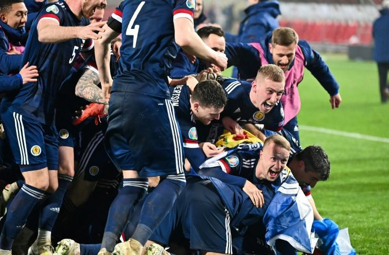 Scotland players celebrate qualifying for a major international tournament for the first time since 1998