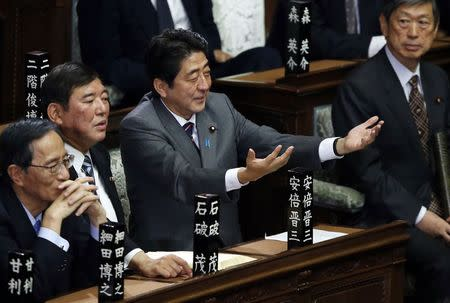 Then incoming Japanese Prime Minister and leader of the Liberal Democratic Party (LDP) Shinzo Abe (2nd R) gestures as he takes his seat at the Lower House of the Parliament in Tokyo, in this file picture taken December 26, 2012. REUTERS/Toru Hanai