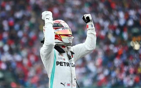 Race winner Lewis Hamilton of Great Britain and Mercedes GP celebrates in parc ferme during the F1 Grand Prix of Mexico at Autodromo Hermanos Rodriguez on October 27, 2019 in Mexico City - Credit: Getty Images