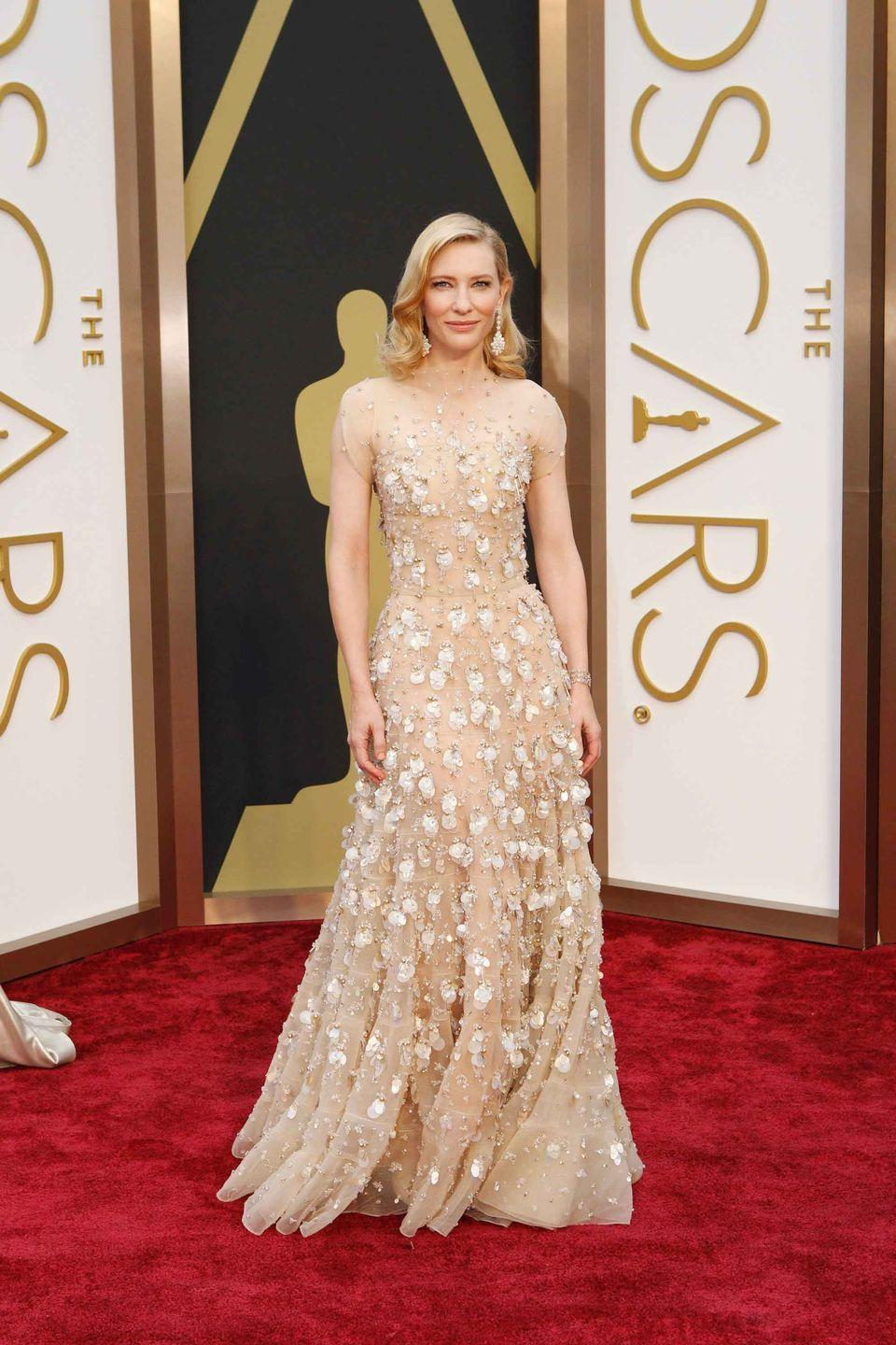 <p>Cate Blanchett in neutral colored Armani Prive gown with flower embellishments.</p>