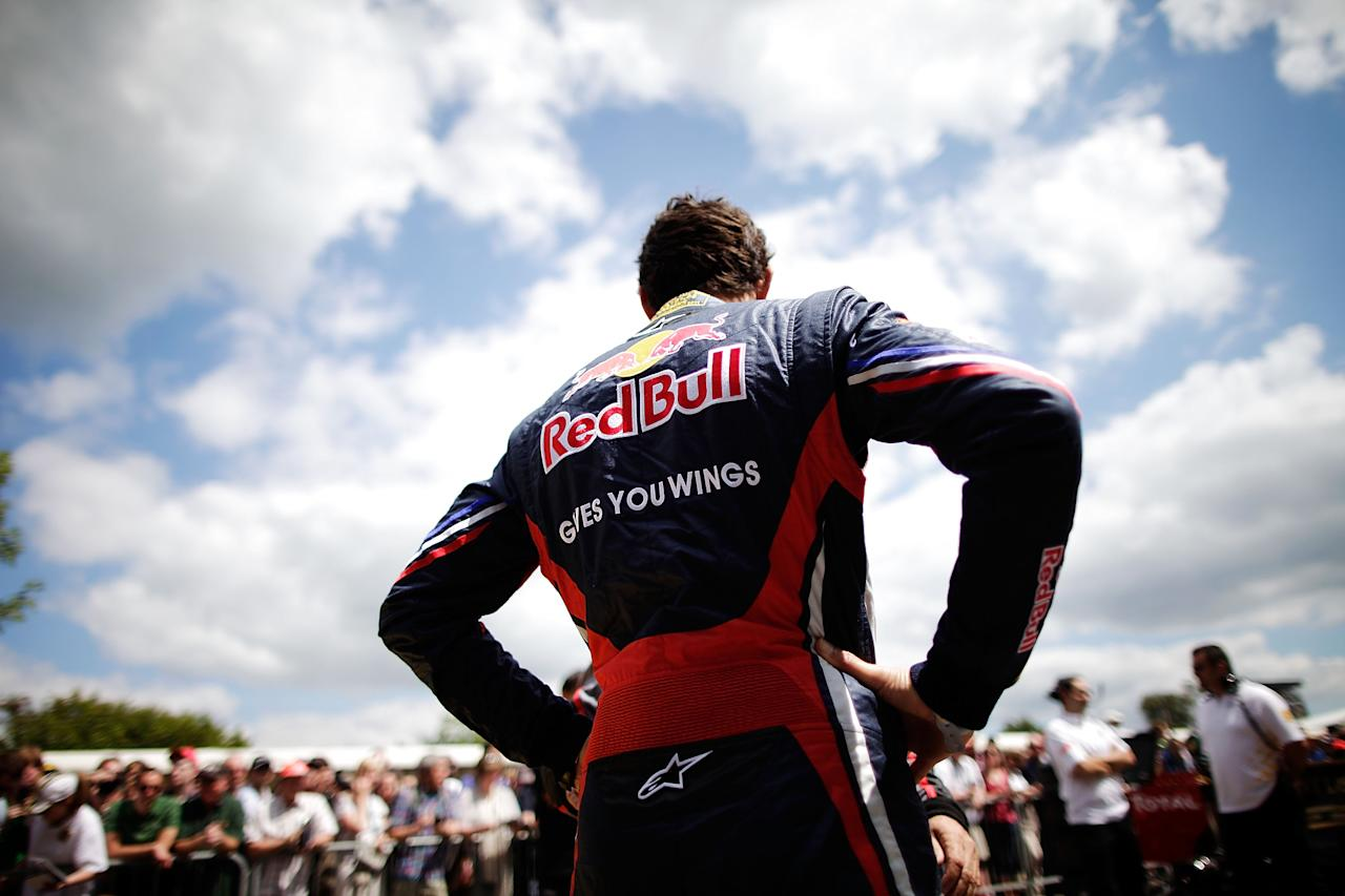 CHICHESTER, ENGLAND - JULY 01:  Red Bull Racing driver Mark Webber waits as his car is prepared in the assembly area prior to a run at the Goodwood Festival of Speed on July 1, 2011 in Chichester, England. Drivers compete in a variety of cars, from vintage models to modern Formula 1 cars in the annual hill climb.  (Photo by Matthew Lloyd/Getty Images)