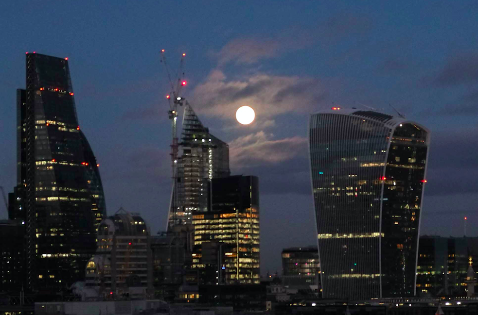 <p>The London skyline was made even more impressive by the Wolf Moon. (Rex) </p>