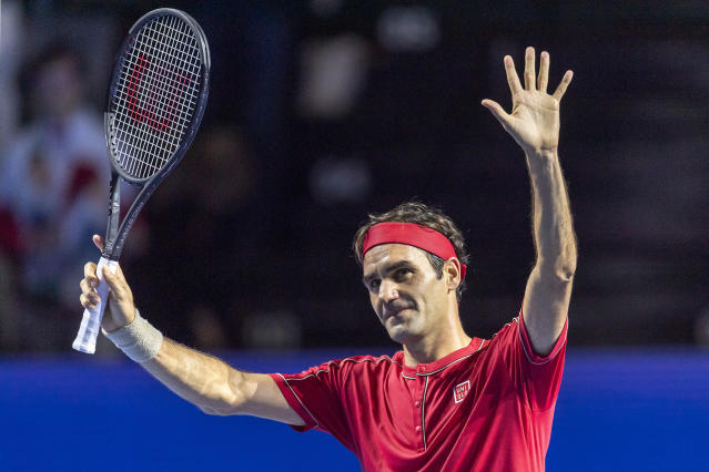Switzerland's Roger Federer acknowledges the crowd after winning his first round match against Germany's Peter Gojowczyk at the Swiss Indoor tennis tournament at the St. Jakobshalle in Basel, Switzerland, on Monday, Oct. 21, 2019. (Georgios Kefalas/Keystone via AP)