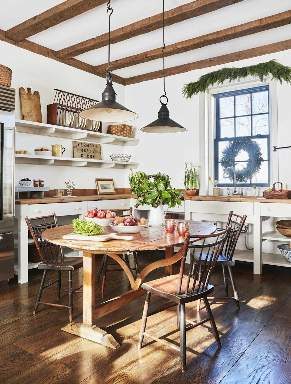 "<p>This <a href=""https://www.veranda.com/decorating-ideas/a29416530/gil-schafer-vermont-party-barn/"" rel=""nofollow noopener"" target=""_blank"" data-ylk=""slk:antiques-filled party barn"" class=""link rapid-noclick-resp"">antiques-filled party barn</a> designed by <a href=""https://gpschafer.com/"" rel=""nofollow noopener"" target=""_blank"" data-ylk=""slk:Gil Schafer"" class=""link rapid-noclick-resp"">Gil Schafer</a> is delicately lit with Edison-style pendants from <a href=""https://hmwpa.com/scofield-lighting/"" rel=""nofollow noopener"" target=""_blank"" data-ylk=""slk:Scofield Lighting"" class=""link rapid-noclick-resp"">Scofield Lighting</a>. It's the perfect option for a well-collected farmhouse kitchen, looking like another find from the owner's travels or local treasure hunts. </p>"