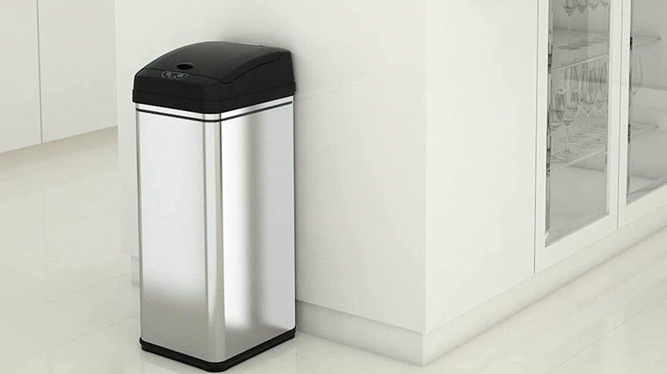 Add a little magic to your kitchen with this automatic trash can.