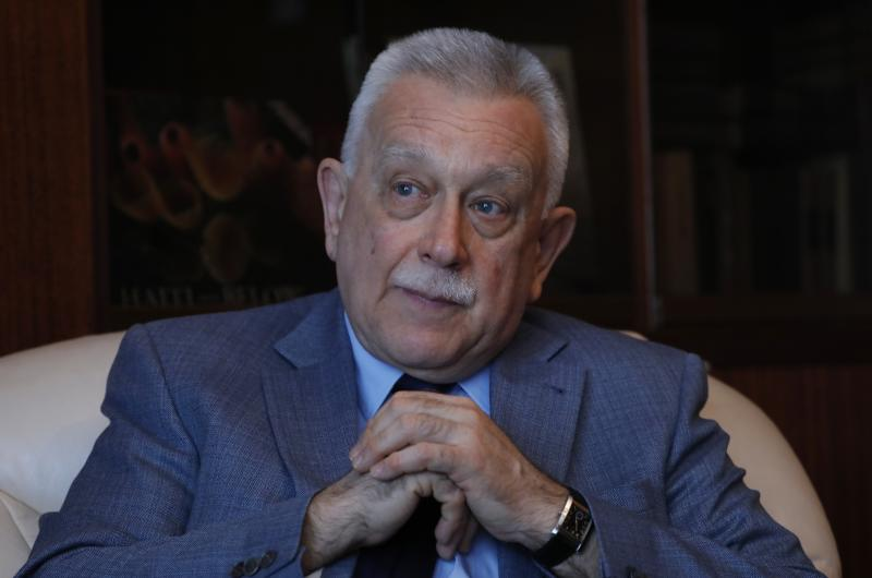 Russia's ambassador to Venezuela, Vladimir Zaemskiy, gives an interview in Caracas, Venezuela, Wednesday, April 17, 2019. As Venezuela's reliance on Russia grows amid the country's unfolding crisis, Vladimir Putin's point man in Caracas is pushing back on the U.S. revival of a doctrine used for generations to justify military interventions in the region. (AP Photo/Ariana Cubillos)