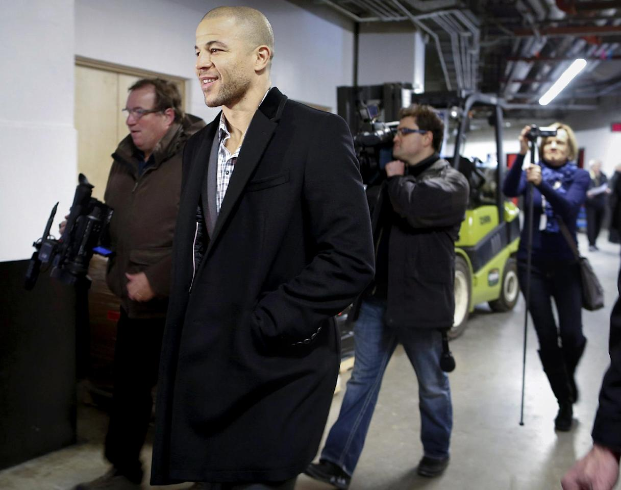 Boston Bruins' Jarome Iginla enters the Saddledome in Calgary, Altuna, Monday, Dec. 9, 2013. It was Iginla's first time back in Calgary after being traded to the Pittsburgh Penguins last season on Monday. (AP Photo/The Canadian Press, Jeff McIntosh)