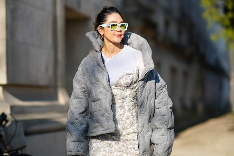 PARIS, FRANCE - JANUARY 22: Araya Hargate wears white sunglasses, gray winter oversized puffer jacket, a white t-shirt, a bejeweled dress with embroidery, earrings, outside Elie Saab, during Paris Fashion Week - Haute Couture Spring/Summer 2020, on January 22, 2020 in Paris, France. (Photo by Edward Berthelot/Getty Images )