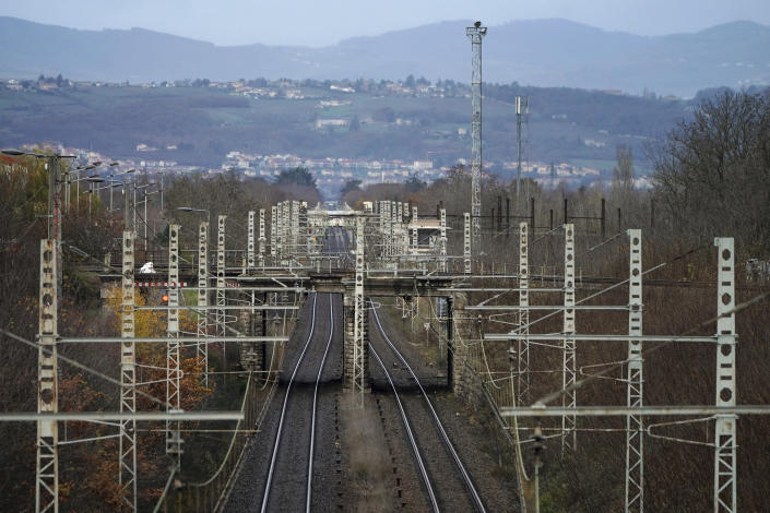 """Rail tracks are pictured during a railway strike at the Saint Germain au Mont d'Or train station, around Lyon, central France, Monday, Dec. 9, 2019. French commuters inched to work Monday through exceptional traffic jams, as strikes to preserve retirement rights halted trains and subways for a fifth straight day. Citing safety risks, the SNCF national rail network issued warned travelers to stay home or use """"alternate means of locomotion"""" to get to work Monday instead of thronging platforms in hopes of getting the few available trains. (AP Photo/Laurent Cipriani)"""