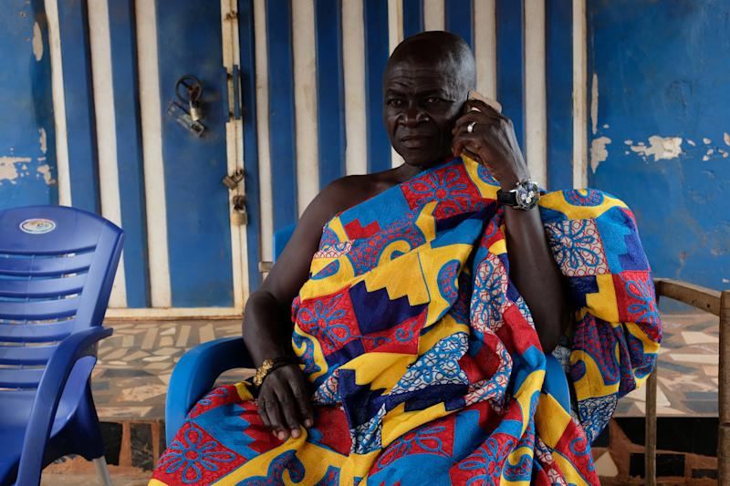 Nana Assenso, chief of Adidwan, a village in Ghana's interior, before visiting the grave of his uncle Kwame Badu, in Adidwan, Ashanti region, Ghana. His uncle's name, Kwame Badu, has been passed on through the family in remembrance of an ancestor with that name who was captured and sold into slavery. (Photo: Francis Kokoroko/Reuters)