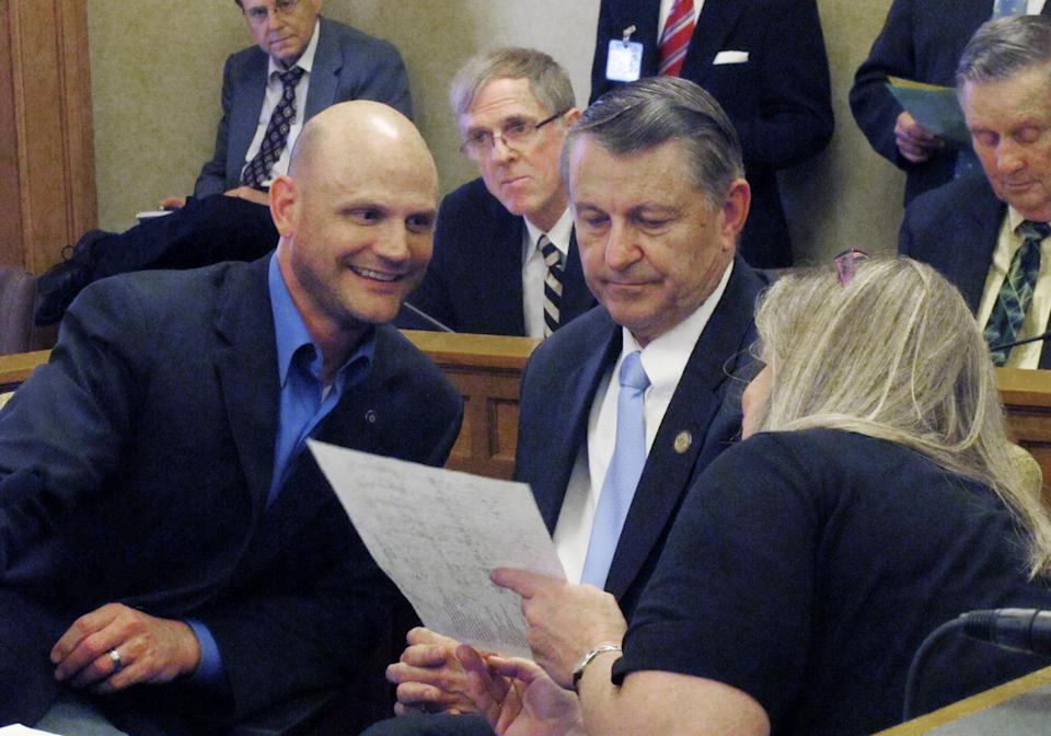 <p> Kansas House tax negotiators Scott Schwab, left, an Olathe Repulblican; Richard Carlson, center, a St. Marys Republican, and Julie Menghini, right, a Pittsburg Democrat, mull over a proposed tax plan from senators during negotiations, Friday, May 31, 2013, at the Statehouse in Topeka, Kan. Lawmakers are trying to resolve their differences on taxes, pass a plan and wrap up their annual session. (AP Photo/John Hanna)</p>