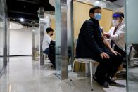 A man gets an influenza vaccine at a branch of the Korea Association of Health Promotion in Seoul