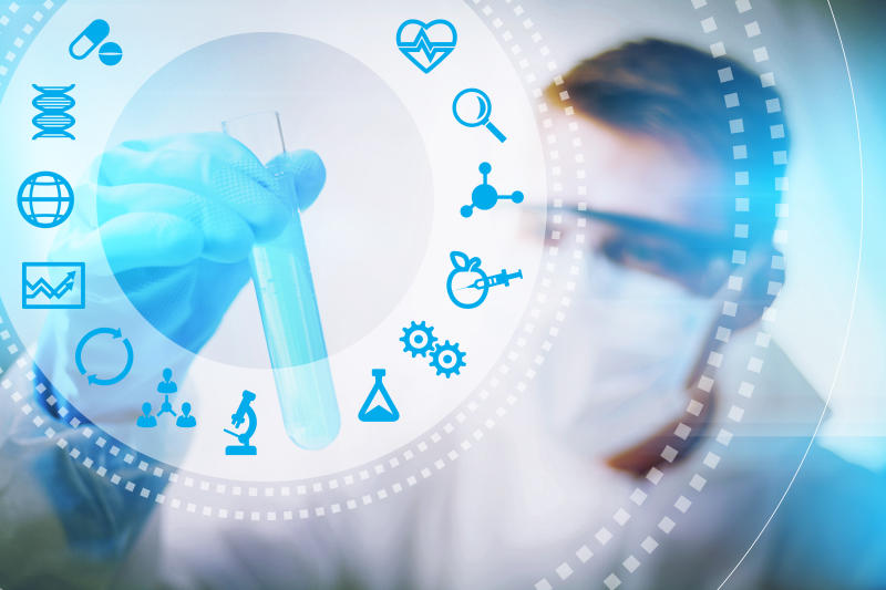 Scientist holding a test tube with biotech-related icons projected in the foreground
