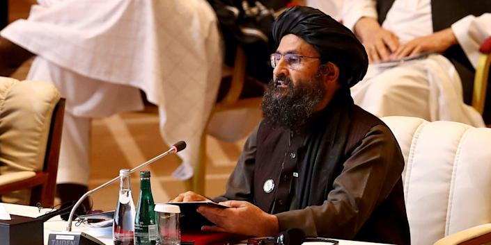 Mullah Abdul Ghani Baradar sitting at a conference table in September 2021.