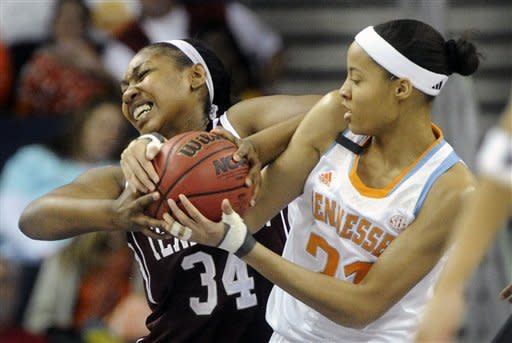 Texas A&M center Karla Gilbert (34) and Tennessee center Nia Moore (21) wrestle for the ball during the first half of an NCAA college basketball game in the Southeastern Conference tournament on Saturday, March 9, 2013, in Duluth, Ga. (AP Photo/John Amis)