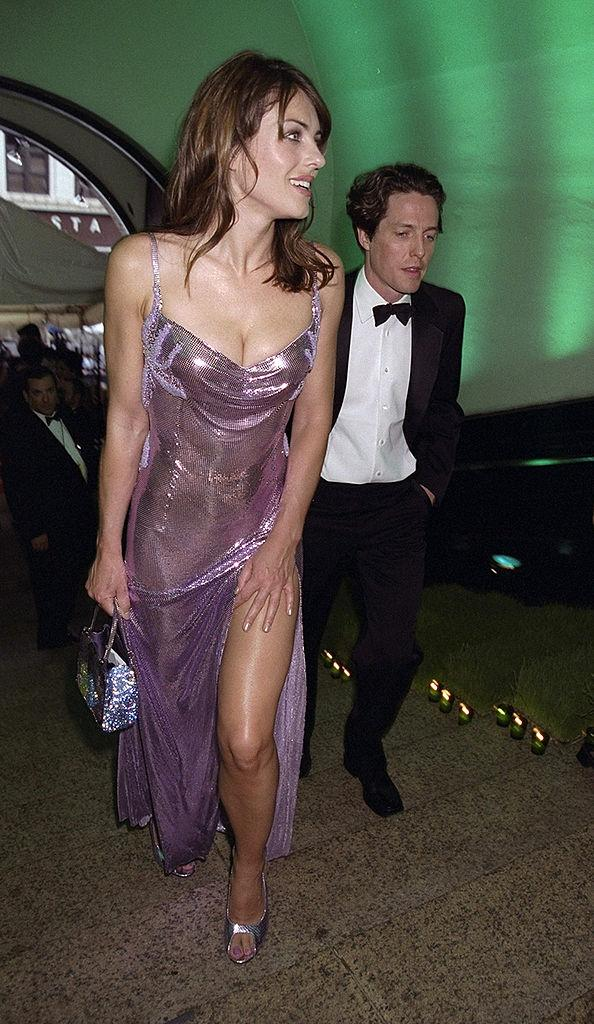 Elizabeth Hurley with Hugh Grant at the 18th annual American Fashion Awards, in June 1999.