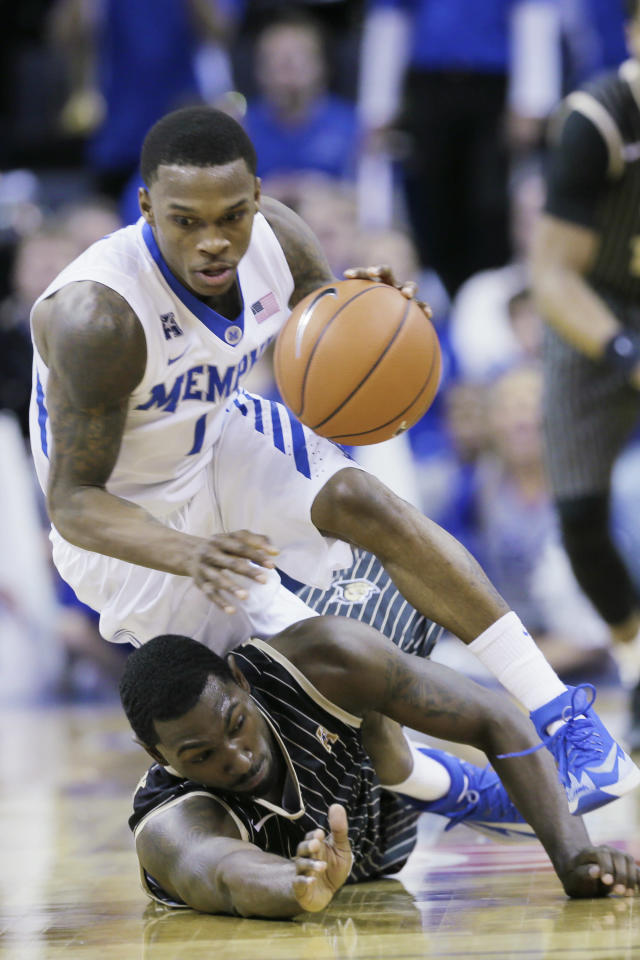 Memphis' Joe Jackson (1) takes the ball away from Central Florida's Tristan Spurlock in the second half of an NCAA college basketball game in Memphis, Tenn., Wednesday, Feb. 12, 2014. Memphis defeated UCF 76-70. (AP Photo/Danny Johnston)