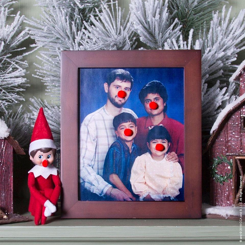"""<p>Clowns, Rudolph...whatever these noses remind you of, one thing's for sure: They'll have your entire family laughing soon enough.</p><p><strong>Get the tutorial at <a href=""""https://elfontheshelf.com/elf-ideas/clownin-around/"""" rel=""""nofollow noopener"""" target=""""_blank"""" data-ylk=""""slk:Elf on the Shelf"""" class=""""link rapid-noclick-resp"""">Elf on the Shelf</a>.</strong></p><p><a class=""""link rapid-noclick-resp"""" href=""""https://go.redirectingat.com?id=74968X1596630&url=https%3A%2F%2Fwww.walmart.com%2Fsearch%2F%3Fquery%3Dpom%2Bpoms&sref=https%3A%2F%2Fwww.thepioneerwoman.com%2Fholidays-celebrations%2Fg34080491%2Ffunny-elf-on-the-shelf-ideas%2F"""" rel=""""nofollow noopener"""" target=""""_blank"""" data-ylk=""""slk:SHOP POM-POMS"""">SHOP POM-POMS</a></p>"""
