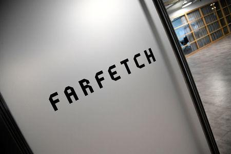 Branding for online fashion house Farfetch is seen at the company headquarters in London, Britain January 31, 2018. REUTERS/Toby Melville