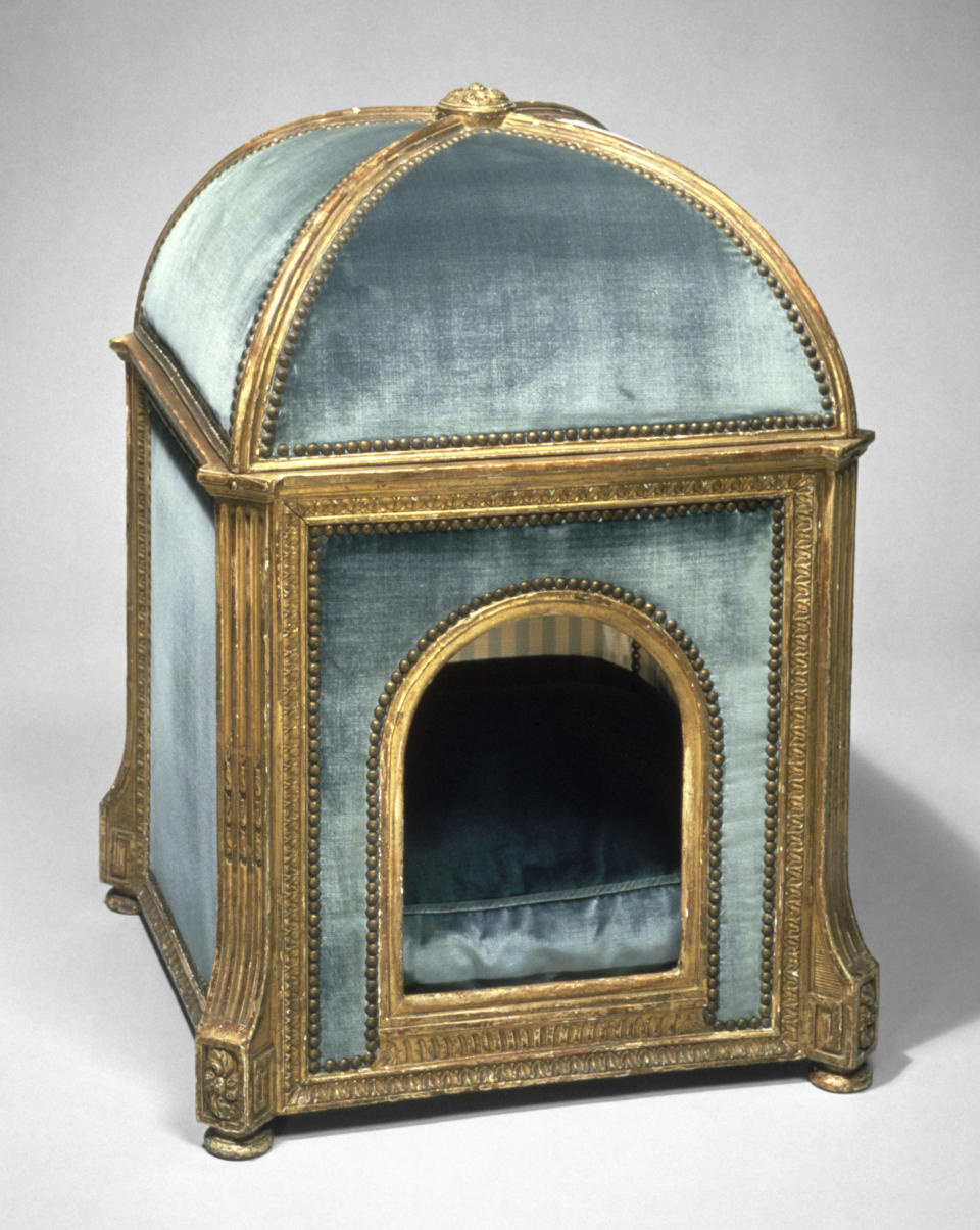 This photo provided by The Metropolitan Museum of Art shows a dog kennel made by Claude I Sené (French, 1724–1792), circa 1775–80. The kennel is made of gilded beech and pine; silk and velvet. The kennel once belonged to Marie Antoinette. No longer are furniture companies content to offer you staples like a sofa, easy chair and bed. Now they have those items for your pet, too, designed not to clash with the rest of your decor. Pottery Barn, Crate and Barrel, Ikea, Casper mattresses and other popular furniture purveyors have lines for pets, often in styles that complement their human-size living room furniture.(Metropolitan Museum of Art via AP)