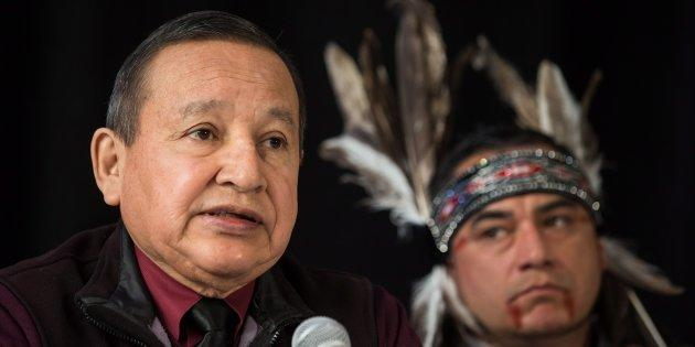 Grand Chief Stewart Phillip, left, president of the Union of B.C. Indian Chiefs, speaks as Will George, a member of the Tsleil-Waututh First Nation and a guardian at the watch house near Kinder Morgan's Burnaby facility, listens during a news conference in Vancouver on April 16, 2018.