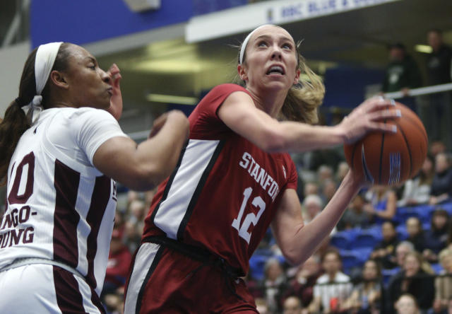 Stanford's Lexie Hull looks to shoot next to Mississippi State's JaMya Mingo-Young during the first half of an NCAA college basketball game Saturday, Nov. 30, 2019, in Victoria, British Columbia. (Chad Hipolito/The Canadian Press via AP)