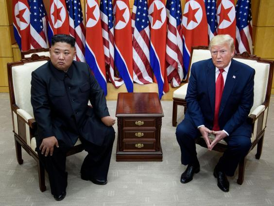 Kim Jong Un and Donald Trump during a meeting in Korea's demilitarised zone in June 2019 (Getty)