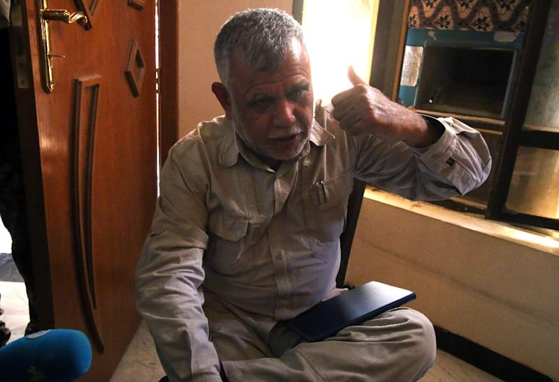Hadi al-Ameri, a commander of Hashed al-Shaabi, an Iraqi paramilitary umbrella that is dominated by Shiite militias, gestures as he speaks to journalists in Fallujah on June 26, 2016 (AFP Photo/Haidar Mohammed Ali)
