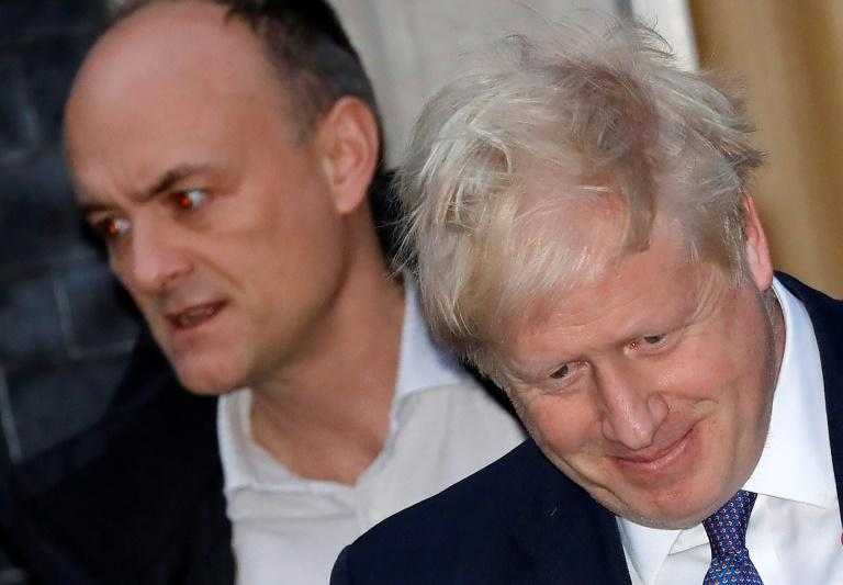 British Prime Minister Boris Johnson pictured with his top adviser Dominic Cummings, who allegedly broke lockdown rules (AFP Photo/Tolga AKMEN)