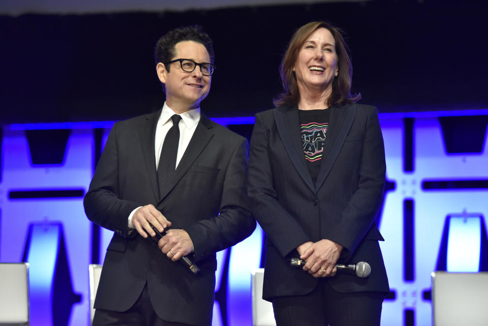 "J.J. Abrams, left, and Kathleen Kennedy participates in the ""Star Wars: The Rise of Skywalker"" panel on day 1 of the Star Wars Celebration at Wintrust Arena on Friday, April 12, 2019, in Chicago. (Photo by Rob Grabowski/Invision/AP)"