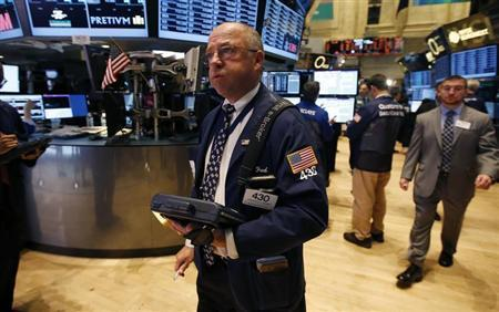 A trader works on the floor of the New York Stock Exchange (NYSE) just after the opening bell, October 10, 2013. REUTERS/Mike Segar