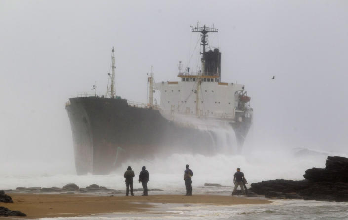 A ship which broke free from a tow line lies stranded near the shore at Sheffield Beach some 60km (37 miles) north of Durban, July 26, 2011. (REUTERS/Rogan Ward)