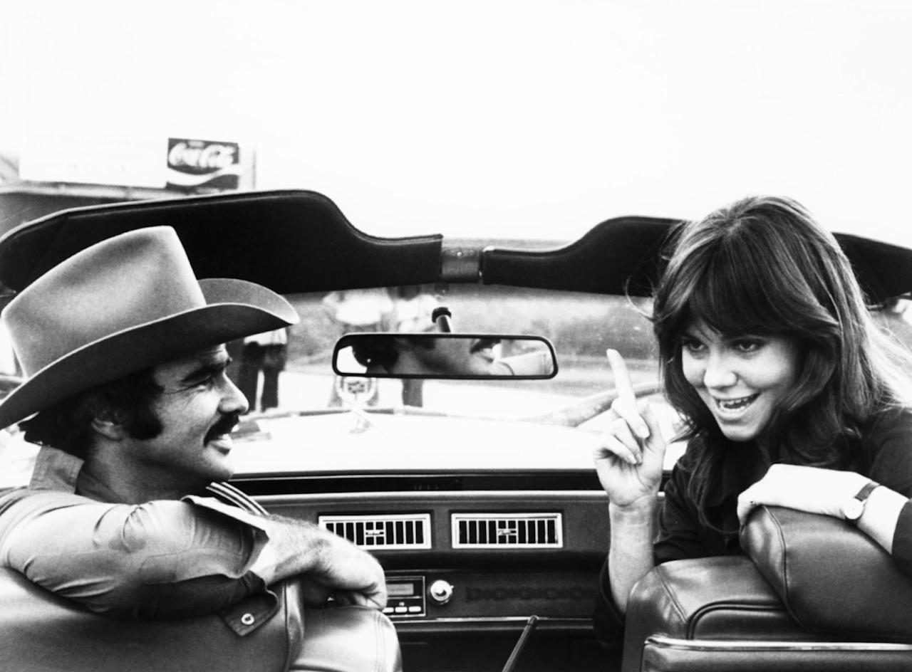 <p>If you argued that his cowboy hat-wearing character, Bandit, was Reynolds's most iconic role to date, it's doubtful that many would disagree. Reynolds went on to star in two sequels after the success of <em>Smokey and the Bandit. </em>(Photo: Universal/courtesy Everett Collection) </p>