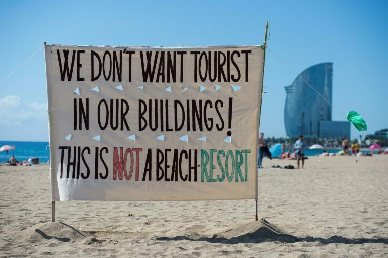 No escape: In Barcelona, protesters have hit the beaches to make their message heard