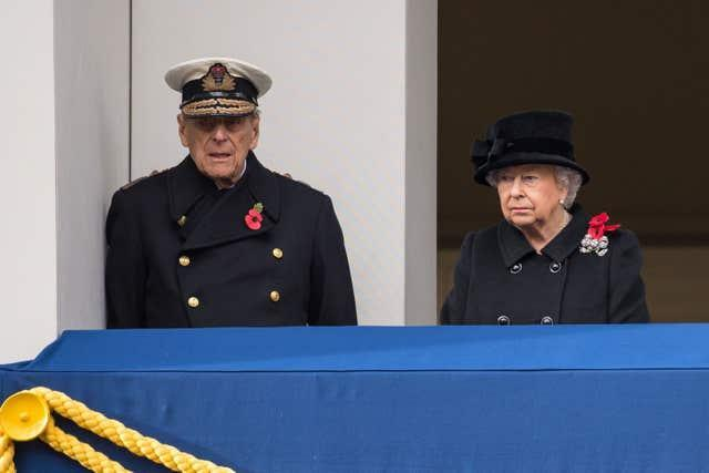 The Queen and the Duke of Edinburgh observing from a balcony during the annual Remembrance Sunday Service at the Cenotaph memorial in Whitehall, central London, in 2017