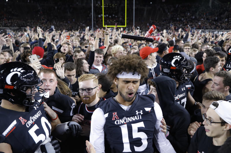 Cincinnati wide receiver Garyn Prater (15) celebrates after the team's 27-24 win over UCF in an NCAA college football game Friday, Oct. 4, 2019, in Cincinnati. (AP Photo/John Minchillo)