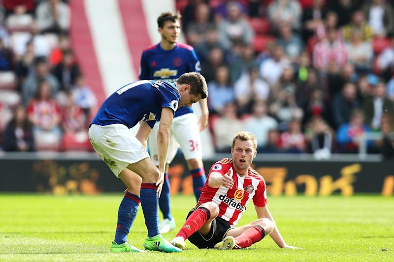 Ander Herrera rubs his leg after the tackle