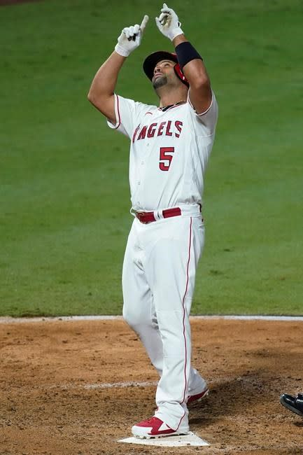 Pujols moves past Mays on HR list; A's clinch playoff spot
