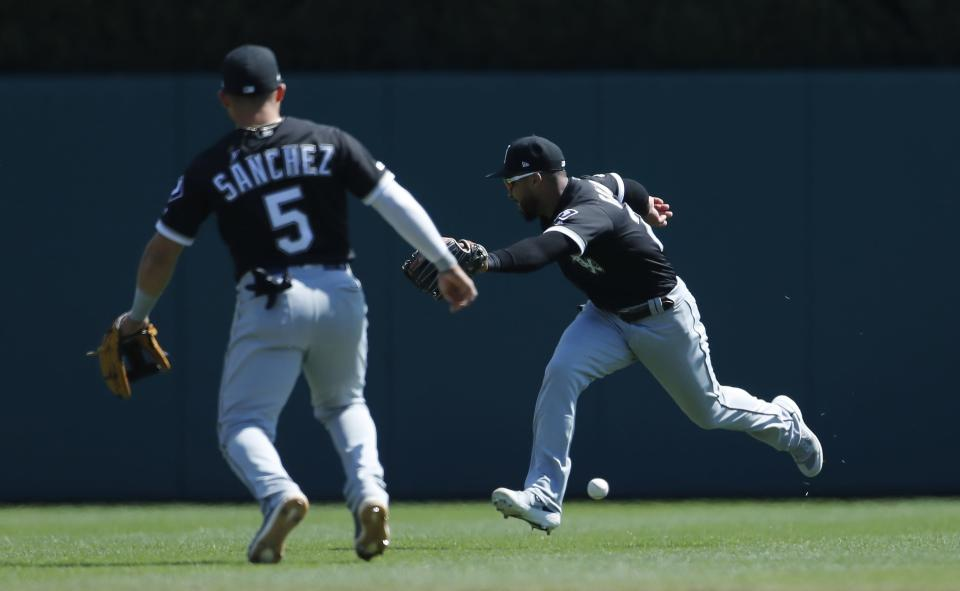 Chicago White Sox center fielder Leury Garcia, right, misplays a ball during the sixth inning of a baseball game, Sunday, April 21, 2019, in Detroit. (AP Photo/Carlos Osorio)