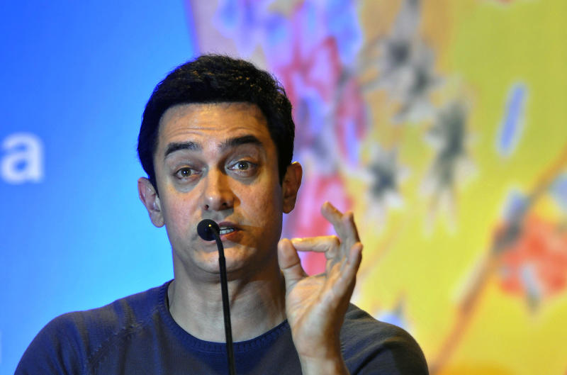 """FILE- In this Nov. 30, 2011 file photo, Indian Bollywood actor Aamir Khan speaks during an event where he was appointed as the UNICEF ambassador promoting nutrition for children, in New Delhi, India. Bollywood megastar Khan is making India confront its dark side. Shining light on inequities like the rampant abortion of female fetuses, caste discrimination and the slaying of brides in dowry disputes, actor Khan has reached an estimated one-third of the country with a new TV talk show """"Satyamev Jayate"""", or """"Truth Alone Prevails,"""" that tackles persistent flaws of modern India that most of its citizens would prefer to ignore.(AP Photo/Tsering Topgyal, file)"""