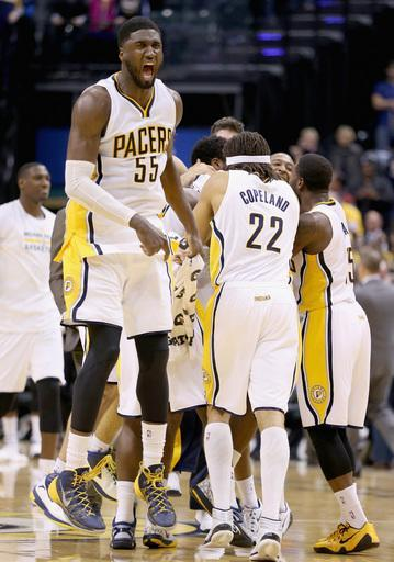 INDIANAPOLIS, IN - NOVEMBER 19: Roy Hibbert #55 of the Indiana Pacers celebrates after the Pacers beat the Charlotte Hornets on a last second basket at Bankers Life Fieldhouse on November 19, 2014 in Indianapolis, Indiana.The Pacers won 88-86. (Photo by Andy Lyons/Getty Images)