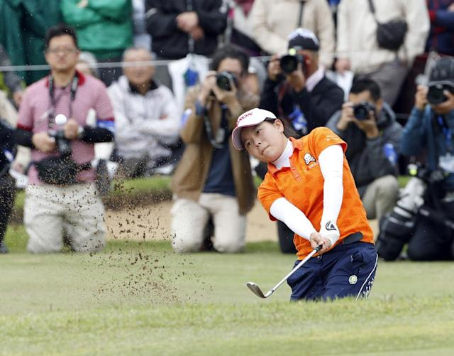 Minami Katsu hits out of a bunker on the 18th hole during the Vantelin Ladies Open golf tournament at Kumamoto Airport Country Club in Kumamoto, southwestern Japan, Sunday, April 20, 2014. Katsu, a 15-year-old Japanese high school student, won the tournament to become the youngest winner in the history of the Japan LPGA tour. (AP Photo/Kyodo News)