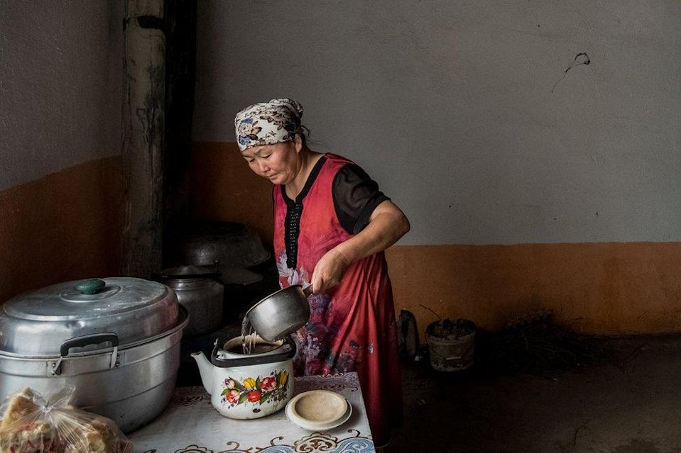 Gulzira Auelkhan makes tea at home in her village. She was detained for 18 months