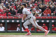 Washington Nationals' Bryce Harper hits a single off Cincinnati Reds starting pitcher Homer Bailey in the third inning of an opening day baseball game, Friday, March 30, 2018, in Cincinnati. (AP Photo/Gary Landers)