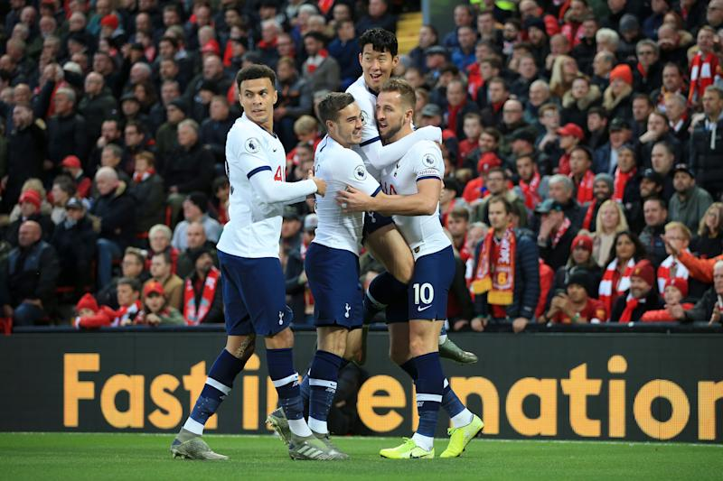 LIVERPOOL, ENGLAND - OCTOBER 27: Harry Kane of Spurs (R) celebrates with Dele Alli of Spurs (L), Harry Winks of Spurs (2L), and Son Heung-Min of Spurs (2R) after scoring their 1st goal during the Premier League match between Liverpool FC and Tottenham Hotspur at Anfield on October 27, 2019 in Liverpool, United Kingdom. (Photo by Simon Stacpoole/Offside/Getty Images)